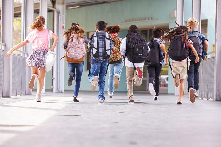 Photo of kids running to school
