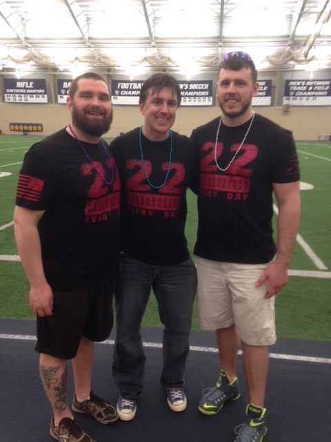 Scott Palasik (center) is flanked by two student veterans during the 2018 Out of the Darkness campus walk event at The University of Akron.