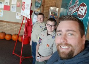 Salvation Army bell ringing for Boy Scouts with his sons Dylan (left) and Ethan (middle)
