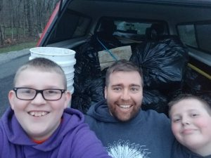 Jamie Jones with sons after picking up trash on the streets for Boy Scouts