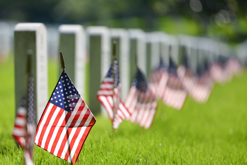 American flags in a cemetery.