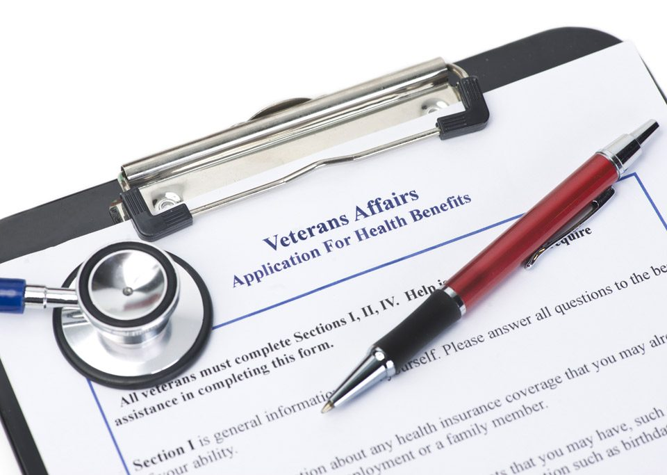 Clipboard with VA Heath Care application form