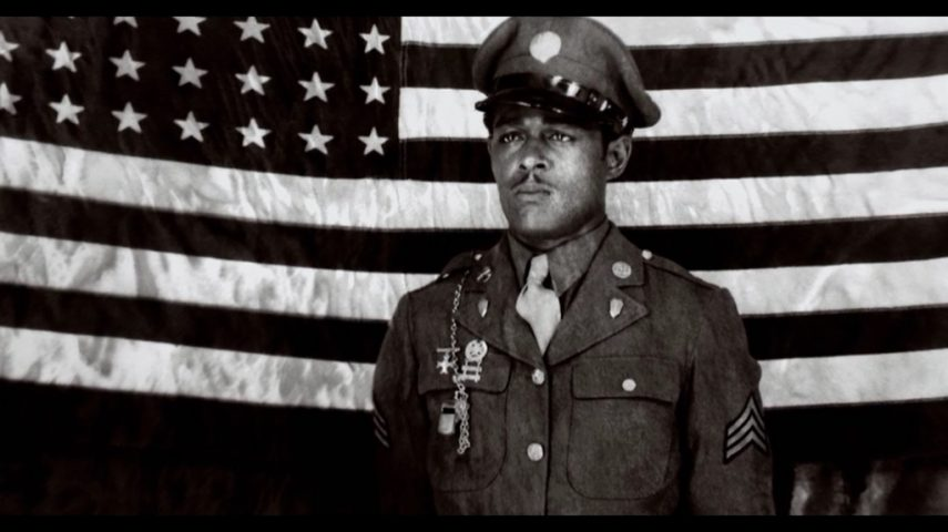 Edward Carter Jr in front of an American flag